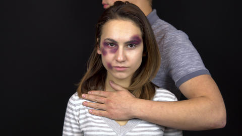 A young man hugs a young woman. A woman with bruises on her face. Quarrel in a Live Action