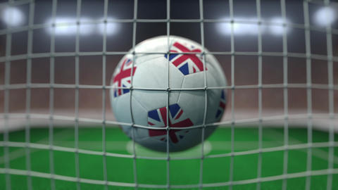Football with flags of Great Britain hits goal net. Slow motion 3D animation Live Action