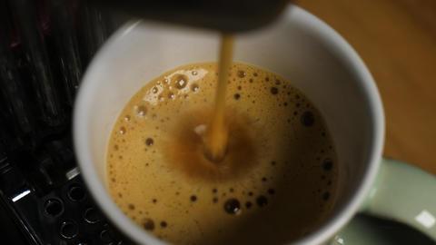 The espresso machine makes a fresh delicious espresso coffee Live Action