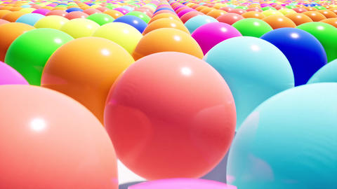 Camera movement over a realistic field of colored plastic balls. Design element Live Action