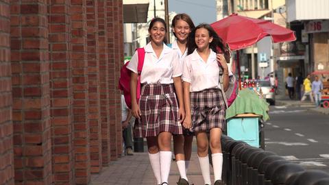 School Girls Walking On Sidewalk Footage