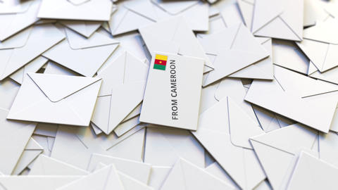 Letter with From Cameroon text on pile of other Letters. International mail Live Action