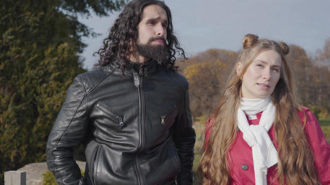 Portrait of carefree Middle Eastern man and Caucasian woman standing in autumn Live Action