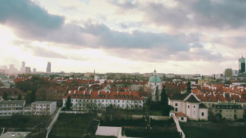 Aerial view of St. Kazimierz Church and Church of St. Benon within Warsaw Live Action