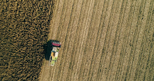 Combine harvester coming back from harvesting corn aerial drone shot agriculture 02 Live Action