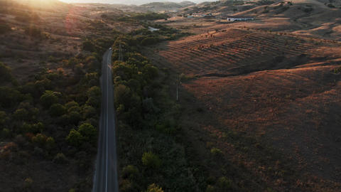 Panorama of the landscape shot from the air. Several cars appear on the road Live Action