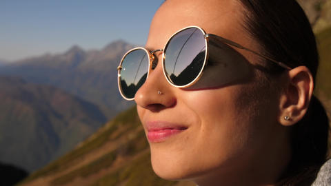 Woman enjoying of a view of mountains Live Action