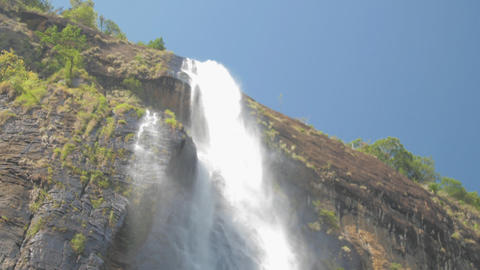 pictorial large waterfall under clear blue sky slow motion Live Action