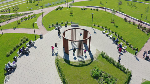 children play with round swings in nice park aerial view 실사 촬영