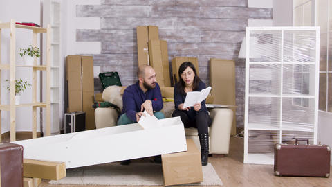 Zoom in shot of young couple assembing furniture Live Action