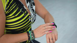 Fitness woman using smart watch on bicycle training in sport club. Sport woman Live Action