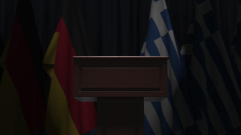 Flags of Germany and Greece and speaker podium tribune. Political event or Live Action