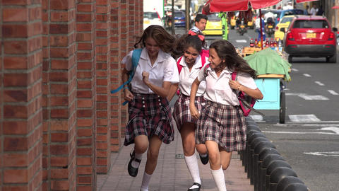 Female Students Running On Sidewalk Live Action