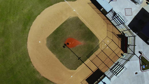 Aerial spin descend on baseball field pitcher's mound, 4K Footage