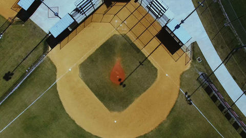 Aerial descend on baseball field pitcher's mound, 4K Footage
