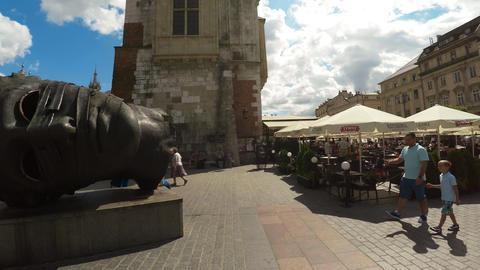 Head sculpture Eros Bendato on Market Square in Krakow. 4K Footage