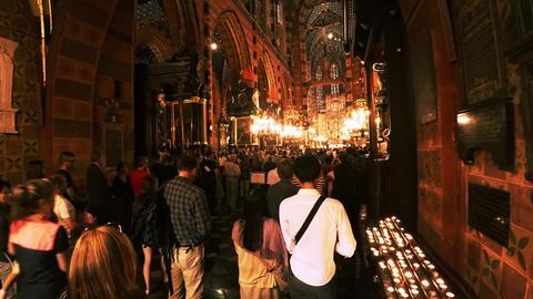 Prayer in the Catholic church of St. Mary's Church. Krakow. Poland. 4K Live Action
