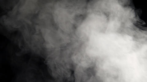 Abstract white smoke on black background 실사 촬영
