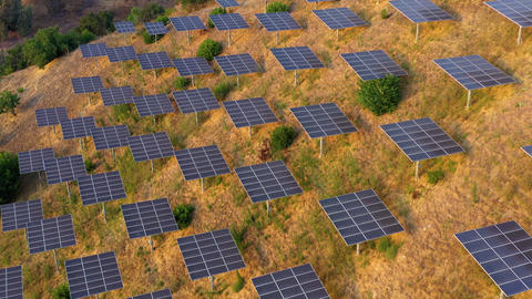 Aerial shot of a hillside in Southern California covered with solar panels 실사 촬영