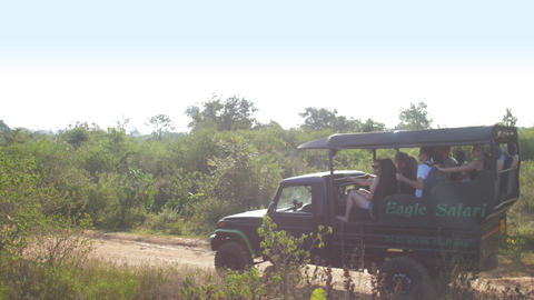 modern sport utility vehicle with group of tourists drives Live Action