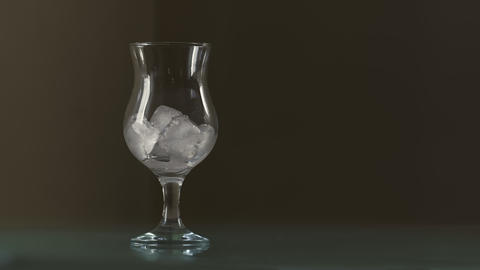 Pouring Lemonade With Ice Cubes And Bubbles In Glass Live Action