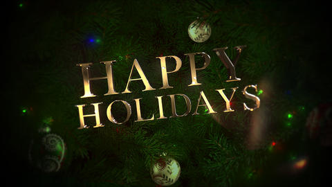 Animated close up Happy Holidays text, colorful balls and green tree branches on shiny background Animation