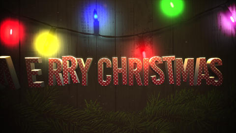 Animated closeup Merry Christmas text and colorful garland on wood background 애니메이션