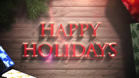 Animated close up Happy Holidays text, gift boxes and green tree branches on wood background 애니메이션