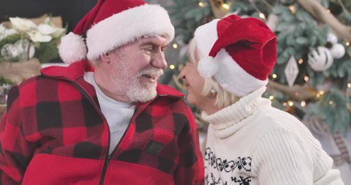 Side view of positive mature Caucasian couple's faces smiling. Husband and wife Live Action