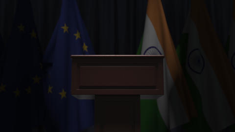 Row of flags of India and the European Union EU and and speaker tribune Live Action