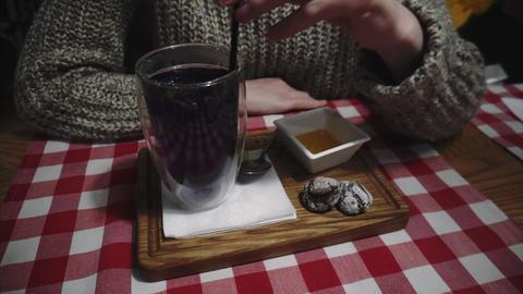 Gourmet girl tastes blue tea Anchan, drinks a hot drink through a sidch in a Live Action