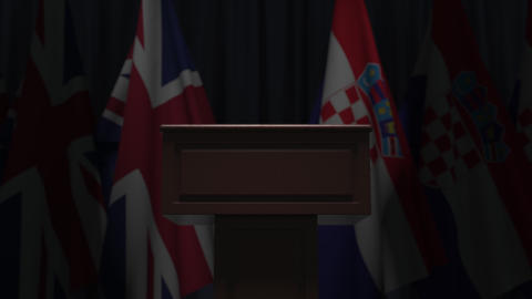Row of flags of Croatia and the United Kingdom and and speaker tribune Live Action