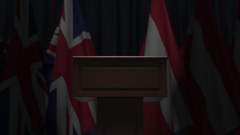 Many flags of Austria and the United Kingdom behind speaker tribune, 3D GIF