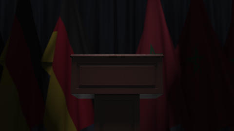 Many flags of Morocco and Germany behind speaker tribune, 3D animation Live Action