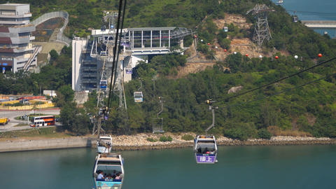 Ngong Ping cable car with Scenic Hill in background Live Action