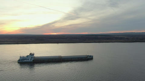 Freight cargo ship floating on sea on sunset landscape. Aerial side view cargo ship with freight Live Action