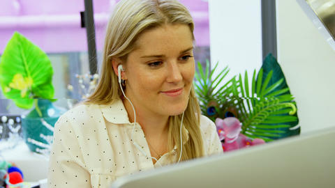 Fashion designer listening music on desktop pc 4k Live Action