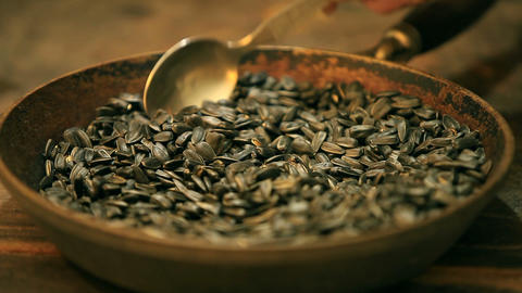 sunflower seeds in a pan Live Action