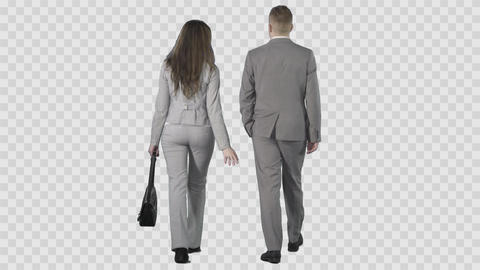 Young male and woman in gray business clothes are going from the camera Footage