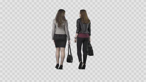 Two beautiful girls are walking away from the camera and watching something Footage