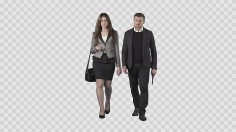 Young man and attractive woman in business clothes are walking at the camera Live Action
