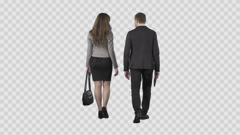 Business man and girl in office suit are slowly walking from the camera Live Action