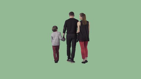 Young family with little boy is slowly walking away the camera. Alpha matte Footage