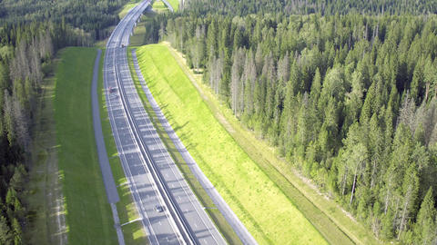 Flight Above Highway in Forest Footage