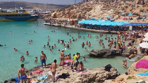 Comino Island, Malta - 03 August 2016: Tourists swimming at the Blue Lagoon Footage