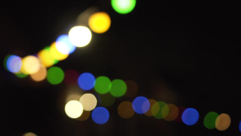 Flashing colored lights. Celebration and party, night city, defocused bokeh Live Action