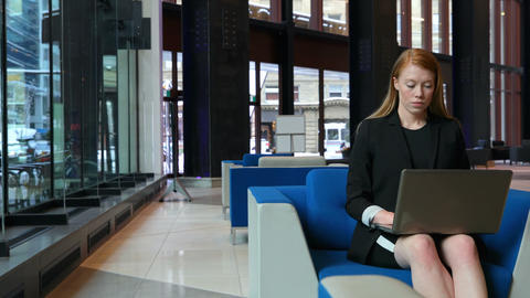 Businesswoman using laptop in office 4k Live Action