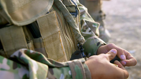 Mid section of military soldier holding rifle magazine during training 4k Live Action