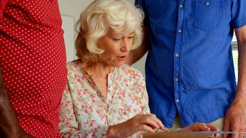 Active Caucasian senior people looking at photo album in nursing home 4k Live Action
