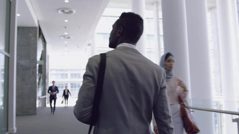 Businessman walking in the corridor at office 4k Live Action